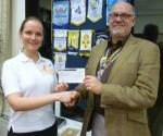 Cheque Presentation in February 2011 - Pres.John presents a cheque to Louise Collins from Chestnut Tree House