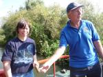 Webcas Drop-in Centre - 2014 Barge Trip - guiding the helm