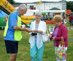 Rotary supports the Summer Festivities at the Carse Country Fair - Paul (with legs) pays visitors to buy ducks