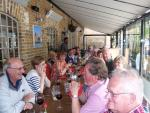 Contact Clubs Visit 2012 - Visitors and local Rotarians tuck into Antipasti and Pizza washed dopwn with litres of wine!