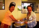Charities we have or are supporting - Pres Sandra giving toiletry packs to Kathy Gledhill of FNH