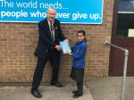 275 Dictionaries 4 Life Presented to Local Schools - President David presents a dictionary to a pupil at Bowling Park Primary