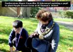 Raising awareness of Rotary's aim to eradicate Polio - Mayor helps a pupil plant crocuses