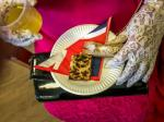 Dementia Cafe Street Party - A gloved royal hand takes a sausage roll