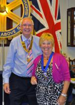 Club Assembly - Bill presents Carol with her Past President jewel.
