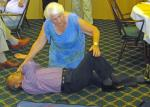 Speaker Evening - Ann showing how to turn a patient over - in this case Satish.