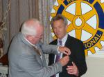 Handover Meeting - John Doyle receives his PP badge from new president Bill Thomas
