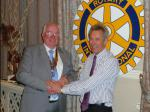 Handover Meeting - Outgoing President, John Doyle, hand over his badge to new President Bill Thomas