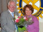 Handover Meeting - Bill Thomas presents Sarah Doyle with flowers from the club.