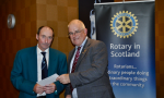 2014 Skye Rotary Annual Awards Dinner - Tony Hanley receives this 500 pounds award for dogs which provide excellent support in highland search and rescue.