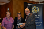 2014 Skye Rotary Annual Awards Dinner - Marie Campbell and Alison Graham receive the 500 pounds award. Crossroads provides invaluable support for carers of the elderly.