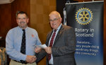 2014 Skye Rotary Annual Awards Dinner - Portree Lifeboat Coxwain, Davey Urquhart accepts this 1,000 pounds award. RNLI volunteers risk their own lives to save others in peril on the sea.