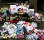 Sandra's Baby Clothes Project - Sandra sorting baby clothes, August 2012
