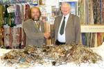 Spectacles Collection - President Terry and Rotarian Arthur with the spectacles donated in Millom in 2011