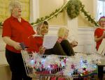 Diamond Jubilee Christmas Lunch     with Guest Speaker Right Reverend Lorna Hood  - The assistance of a trolley was required after the Hospice Choir's rendition of The Twelve Days of Christmas