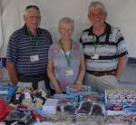 Family Fun Harbour Spectacular 2013 - Tony Key OBE (right) Pembrokeshire Co-ordinator for the Wales Air Ambulance is pictured with volunteers Dennis and Rita Evans of Pembroke