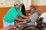 Rotary Clubs adopted a Ugandan Village - Local health workers taking blood pressure