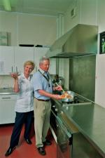 Home Link's new kitchen - Sue Hodder, Manager of Home Link respite care centre with club president Mark Scudamore demonstrating the new equipment