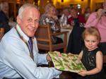 Annual Christmas Celebrations - President Peter presenting prize to winner of children's 'Heads & Tails' competition