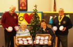 Cheque presentations - Mike Sowden L and David Miller R present Christmas Puddings to Wilma Swankie of Arbroath Town Mission and Major Helen Young of the Salvation Army