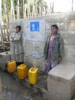International Service - The capped spring feeds a water tank with taps