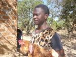 Our Zambia Project - Update - A member of the village moving some of the flock to a new area.