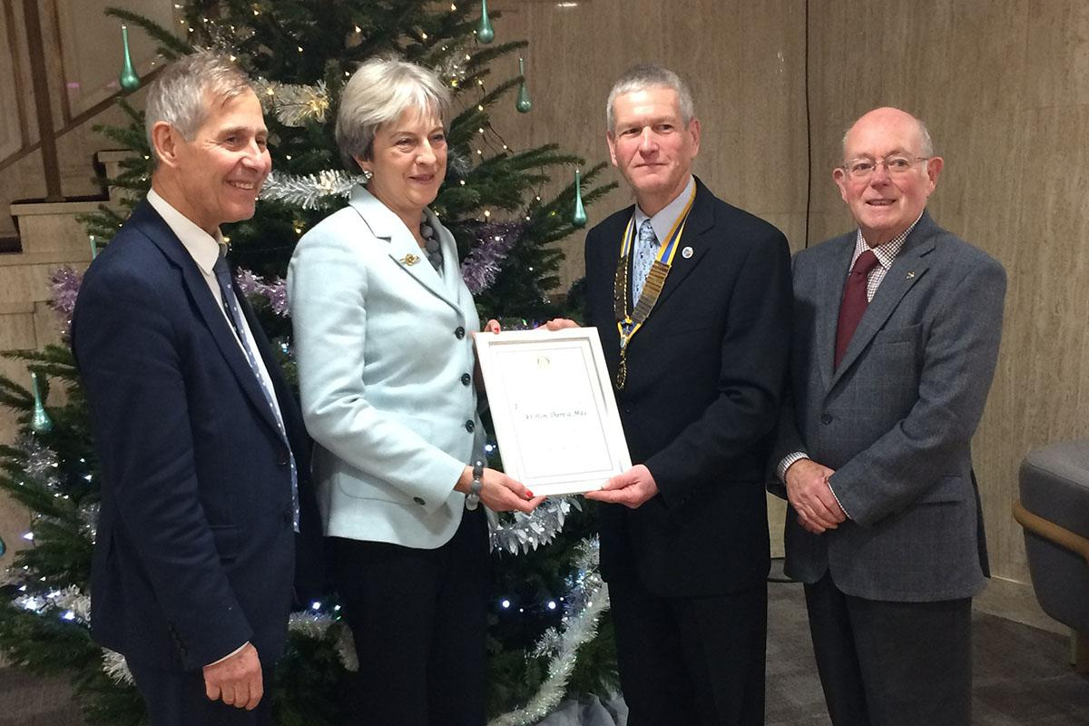 Prime Minister Theresa May welcomed as Honorary Member - Peter Sand, Prime Minister Theresa May, club president John Clegg and Brian McGinley