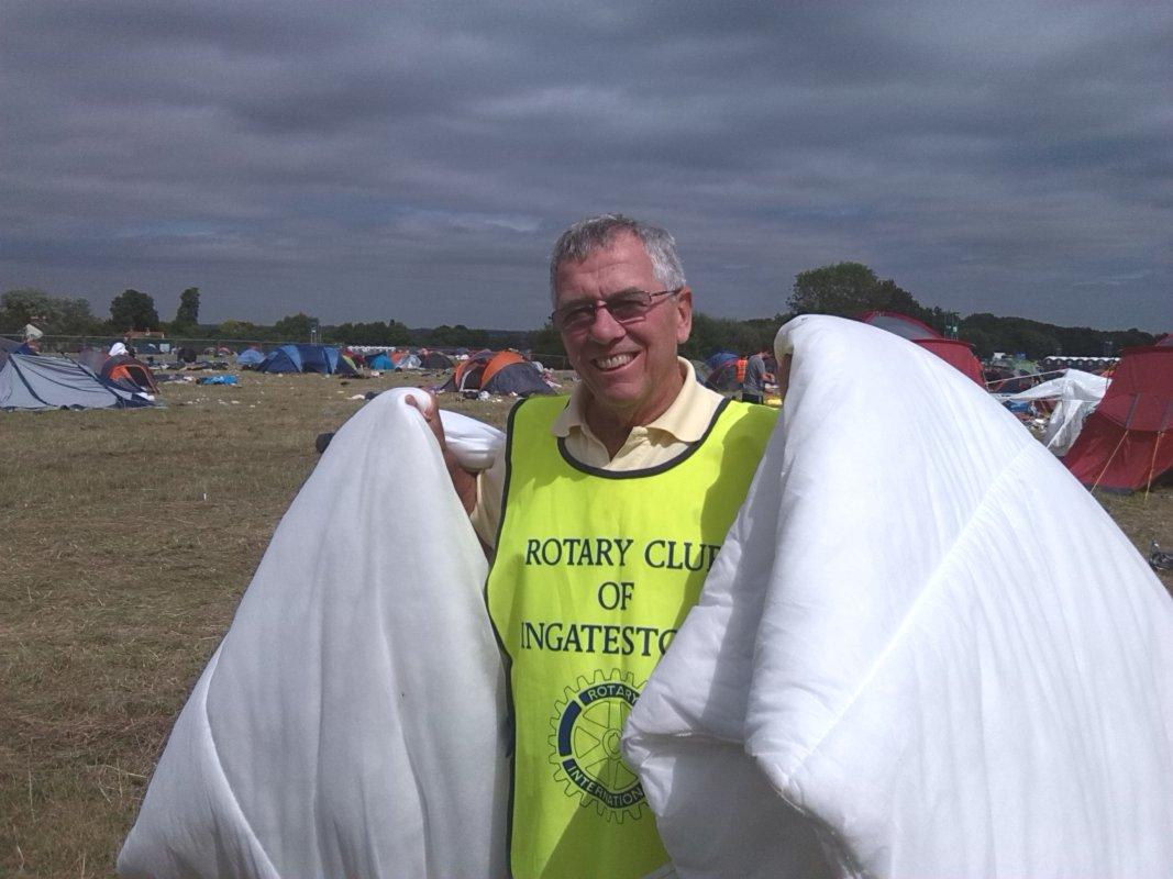V Festival Clear Up 2016 - Ron surrounded by blankets...sorry, Charles doesn't want these!