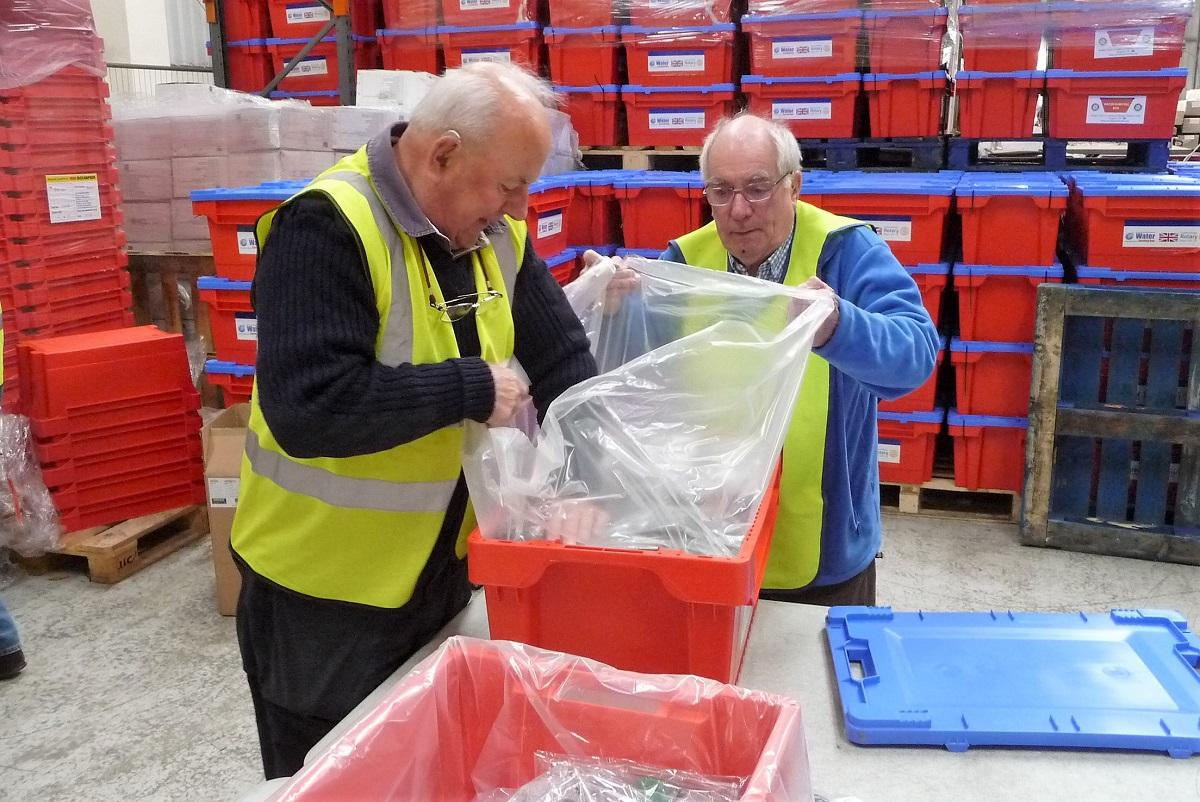 Rotarians packing Water Survival Boxes -