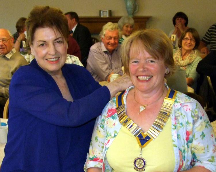 Handover evening 25th June, 2014 - Incoming President Sylvia Ravenhall receives the chain of office from Immediate Past President Rose Dobbs.