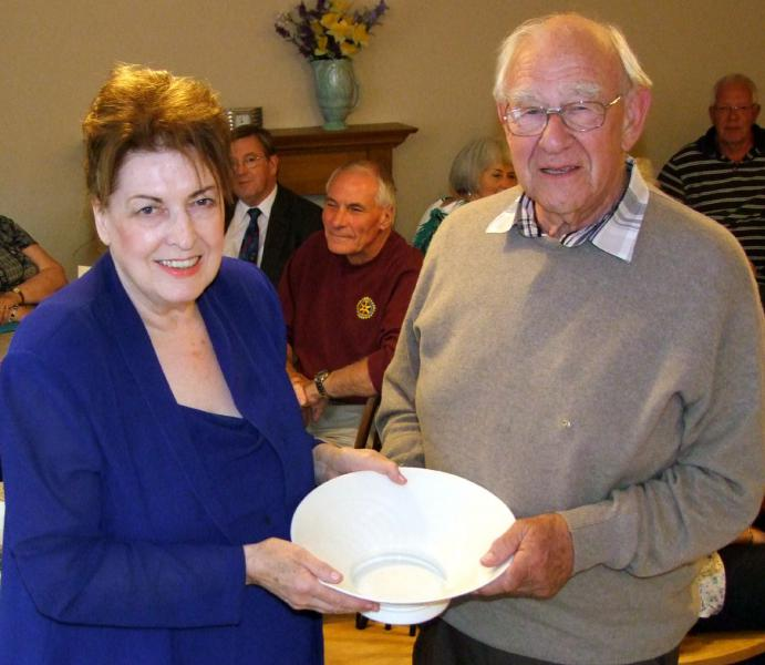 Handover evening 25th June, 2014 - Outgoing President Rose Dobbs presents the Friendship Bowl to Rotarian David Mawby.