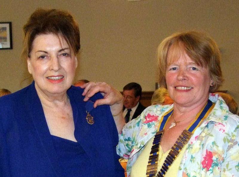 Handover evening 25th June, 2014 - President Sylvia Ravenhall presents the Past President's Badge to Rose Dobbs.