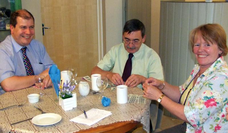Handover evening 25th June, 2014 - Vice President Mike Rinfret, Rotarian Richard Mazur and President Sylvia Ravenhall busy folding up tickets.