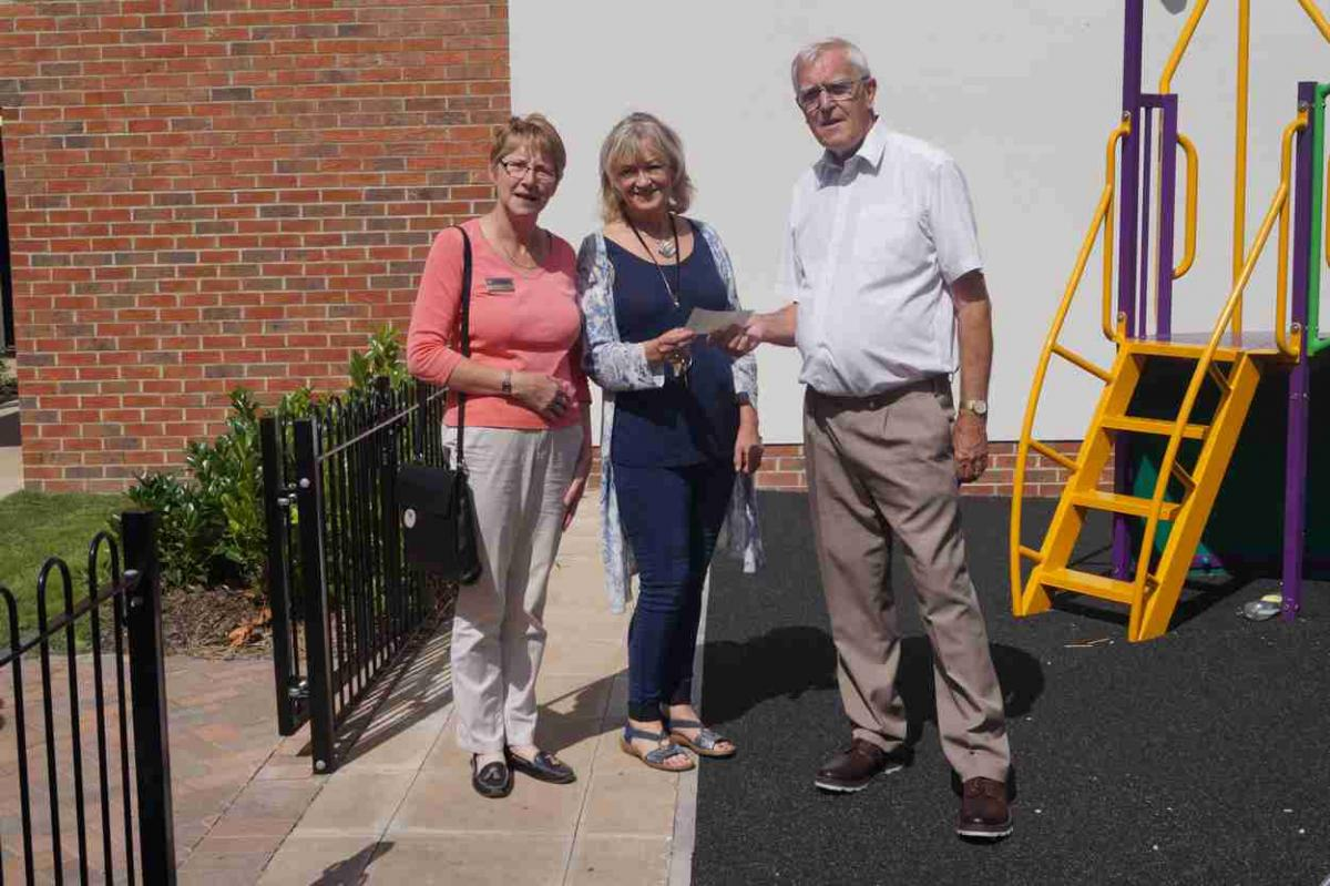 Ironman Staffordshire - annual event - Janet Stubbs of Stafford Knot Rotary Club and John Ogbourne of Eccleshall Mercia Rotary Club present Dickie James with a cheque in support of the work of the centre.  The funds were raised by both Clubs from their stewarding work at the Iron Man 2015 even
