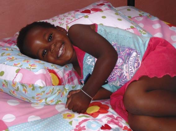 An Kwa Zulu orphan's joy at having a new bed