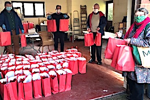 Rotary Club of Eastbourne assembling gift bags